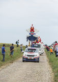 Le Gaulois Caravan on a Cobblestone Road- Tour de France 2015 Stock Photography
