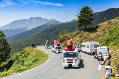 Le Gaulois Caravan in Pyrenees Mountains - Tour de France 2015. Col D'Aspin,France- July 15,2015: Le Gaulois Caravan during the passing of the Publicity Caravan Royalty Free Stock Photo