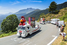 Le Gaulois Caravan in Pyrenees Mountains - Tour de France 2015. Col D'Aspin,France- July 15,2015: Le Gaulois Caravan during the passing of the Publicity Caravan Stock Photography