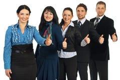 Le gens d'affaires réussi donne des pouces Image stock