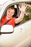 Le gestionnaire du véhicule ondule la main Photos libres de droits