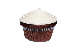 le givrage de gâteau de chocolat a isolé la vanille photos stock