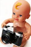 Le gosse avec l'appareil-photo Image stock