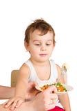 Le gosse ne veut pas manger de la salade Image stock
