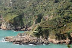 Le Gouffre above Petit Bot Bay, Guernsey Royalty Free Stock Image