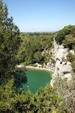 Le Gouffre de l'Oeil Doux, France. Natural small lake and chalk cliffs in the Languedoc Roussillon area of France Stock Images