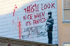 Le graffiti de Banksy Images libres de droits