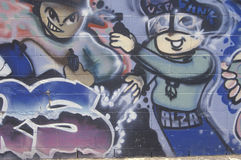 Le graffiti peint sur un mur pendant Los Angeles s'ameute Photographie stock libre de droits