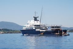 Le Grand Bleu super yacht, Corfu. Super yacht Le Grand Bleu moored in Kerkira harbour on the Greek island of Corfu on June 23, 2014. The 113mtr long boat was stock photography