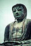 Le grand Bouddha (Daibutsu) en raison du temple de Kotokuin à Kamakura, Japon Photos stock