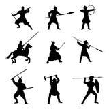 Le grand ensemble de silhouette de guerriers sur le fond blanc Image stock