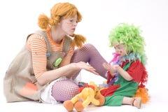 Le grand et petit clown jouent II Photo stock