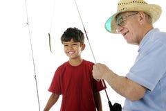 Le grand-papa amorce le crochet Photographie stock libre de droits