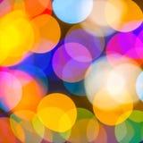 Le grandi luci di bello Natale sottraggono il backgroun variopinto del bokeh Fotografie Stock
