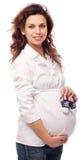 Le gravida kvinnan. Fotografering för Bildbyråer