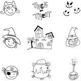 Le griffonnage de l'élément Halloween font face et se retranchent Photographie stock