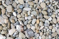 Le gris bascule le gravier naturel de modèle de texture de cailloux Image libre de droits