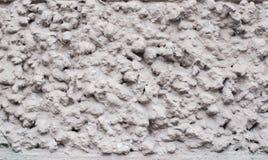 Le gris blanc a pointillé la texture minimalistic de photo avec la surface approximative Images libres de droits