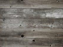 Le gris chaud rustique a survécu au fond en bois de panneau de grange Photographie stock