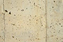 Le gris a perforé la texture de mur en béton photos libres de droits