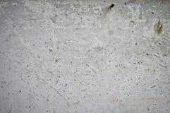 Le gris a perforé la texture de mur en béton image libre de droits