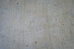 Le gris a perforé la texture de mur en béton photographie stock libre de droits