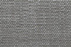 Le gris a tricoté le fond de laine avec un modèle de tissu mou et laineux Texture de plan rapproché de textile Images stock