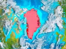 Le Groenland en rouge sur terre Images libres de droits