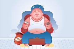 Le gros homme regarde la TV Images libres de droits