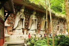 Le grotte della cima della scogliera della montagna del tesoro della contea di Dazu hanno scolpito la pietra Immagini Stock Libere da Diritti