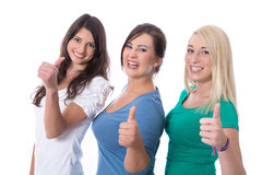 Le groupe de filles heureuses de stagiaires dans les premiers emplois avec des pouces lèvent l'isola Photographie stock libre de droits