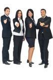 Le groupe de gens d'affaires donne des pouces Photo stock