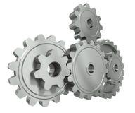 Le groupe de métal engrène - un symbole de travail d'équipe Image stock