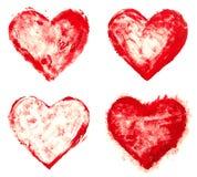 Le grunge a peint des formes rouges de coeur réglées Image stock