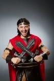 Le guerrier romain avec l'épée sur le fond Photographie stock libre de droits