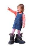 Le gullig liten flicka Arkivbild