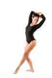 Le gymnaste russe dans le maillot de bain de sports effectue l'exercice image libre de droits