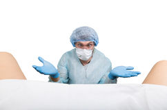Le gynécologue fou examine un patient les différentes émotions d'expression folle de docteur et fait le hand& différent x27 ; sig Image libre de droits