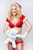 Le härliga och sexiga kvinnaklänningar som ett sexiga Santa Claus Arkivfoto