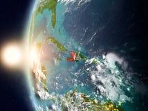 Le Haïti pendant le coucher du soleil sur terre Photos stock
