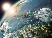 Le Haïti sur terre de planète dans le coucher du soleil Photo libre de droits