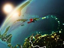 Le Haïti sur terre de planète dans le coucher du soleil Images stock