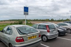 Parked vehicles on a carpool point panel in France. Le Havre, France - May  04, 2018 : Parked vehicles on a carpool point panel in France Stock Photos