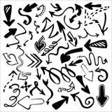 Le icone disegnate a mano delle frecce hanno messo isolato su fondo bianco Fotografia Stock