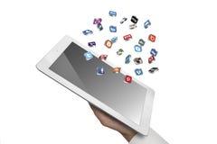 Le icone sociali di media volano fuori dal ipad a disposizione Fotografia Stock Libera da Diritti