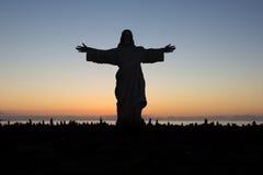 Le Jésus-Christ vous aime - silhouette de statue Photographie stock libre de droits