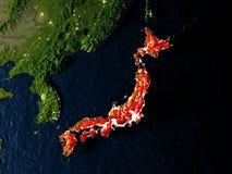 Le Japon en rouge de l'espace la nuit Photos stock