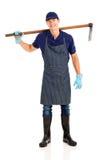 Le jardinier porte la houe photo stock