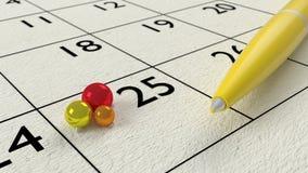 Le jaune ballpen sur un plan rapproché de papier de calendrier Photo libre de droits