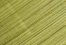 Le jaune a modifié la tonalité la surface de tapis de paille Photographie stock libre de droits